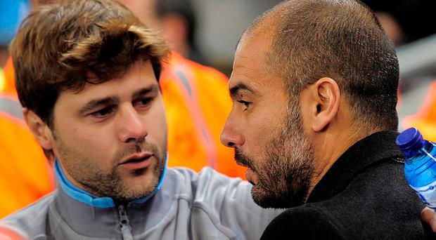 Mauricio Pochettino and Pep Guardiola during Espanyol's game with Barcelona in 2010. Photo: Josep Lago/AFP/Getty Images