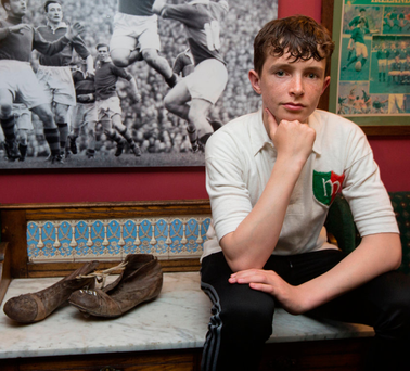 Michael Dawson with his grandfather's jersey and boots from 1951 Photo: Mark Condren