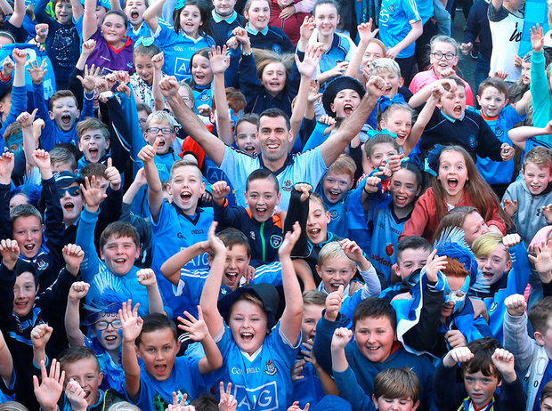 Former Dublin footballer, and principal of Holy Trinity Senior National School in Donaghmede, David Henry (centre) with some of his pupils Photo: Frank McGrath