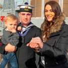 Dean Babbington and girlfriend Niamh Cox with son Jake at Haulbowline Naval Base yesterday Photo: Michael Mac Sweeney/Provision