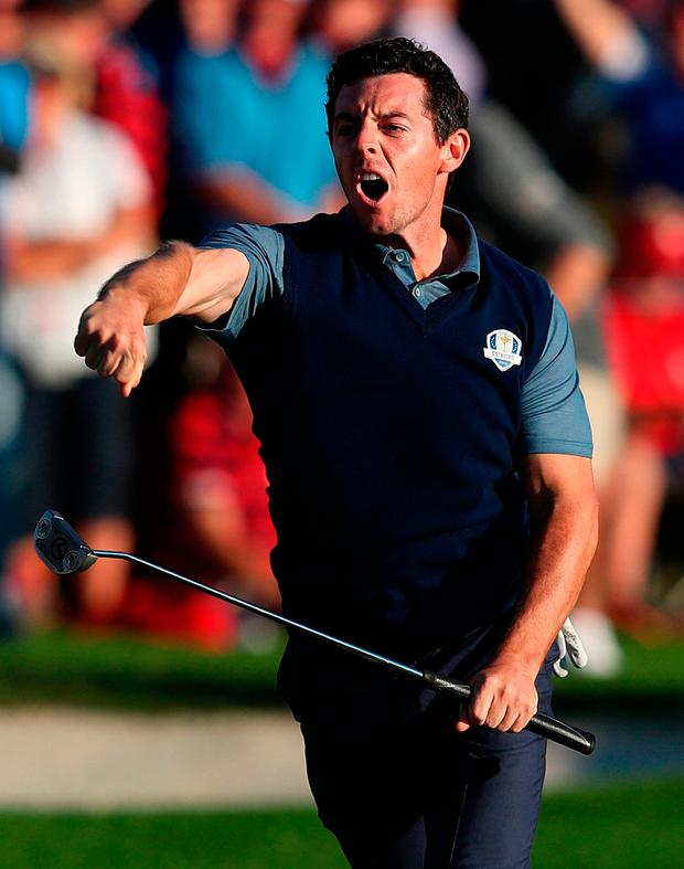 Europe's Rory McIlroy celebrates his putt to win his round during the Fourball's on day one of the 41st Ryder Cup at Hazeltine National Golf Club in Chaska, Minnesota. Photo: PA
