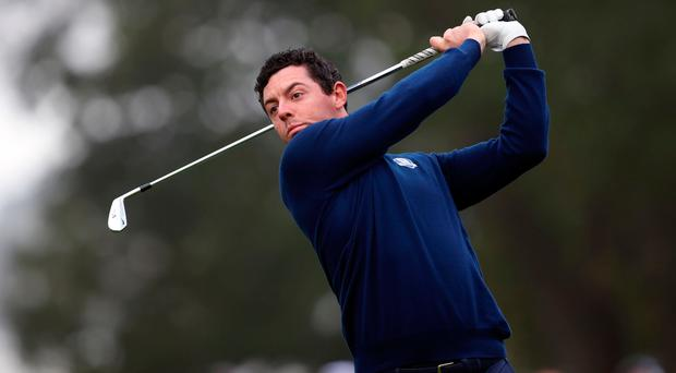 Rory McIlroy plays an iron shot during yesterday's play