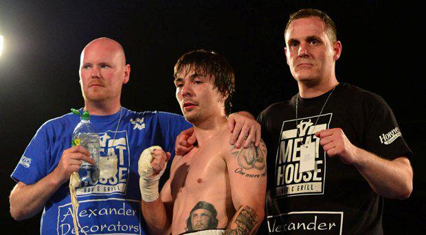 Mike Towell, centre, at the end of a previous bout
