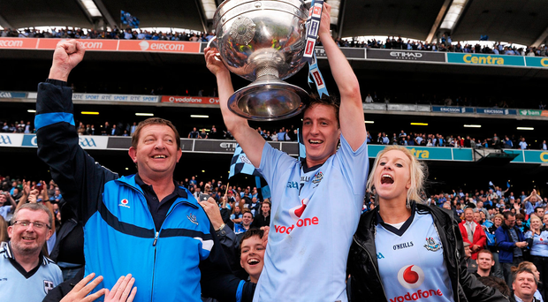 Kevin Nolan, Dublin, celebrates with supporters following his side's victory in 2011