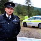 Gardai preserves the scene as Garda Supt. Peter Duff looks on in foreground close to where the mans body was discovered on Ballinascorney Hill in Brittas. Pic Steve Humphreys