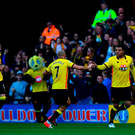 Troy Deeney of Watford celebrates scoring his sides first goal with his team mates during the Premier League match between Watford and AFC Bournemouth at Vicarage Road on October 1, 2016 in Watford, England. (Photo by Dan Mullan/Getty Images)