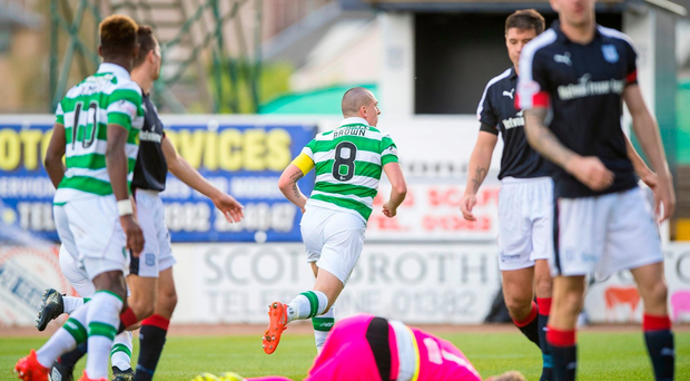 Celtic's Scott Brown celebrates scoring his side's first goal of the game during the Scottish Premiership match at Dens Park, Dundee. PRESS ASSOCIATION Photo.