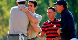 Thomas Pieters and Rory McIlroy of Europe react after winning their match
