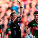 1 October 2016; Lee Keegan of Mayo, right, is shown a black card by referee Maurice Deegan during the GAA Football All-Ireland Senior Championship Final Replay match between Dublin and Mayo at Croke Park in Dublin. Photo by Sam Barnes/Sportsfile