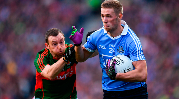 Paul Mannion of Dublin in action against Keith Higgins of Mayo