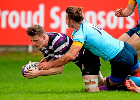 Terenure's Robert Duke scores a try against UCD in the Ulster Bank League game at Lakelands. Photo: Tommy Dickson/INPHO