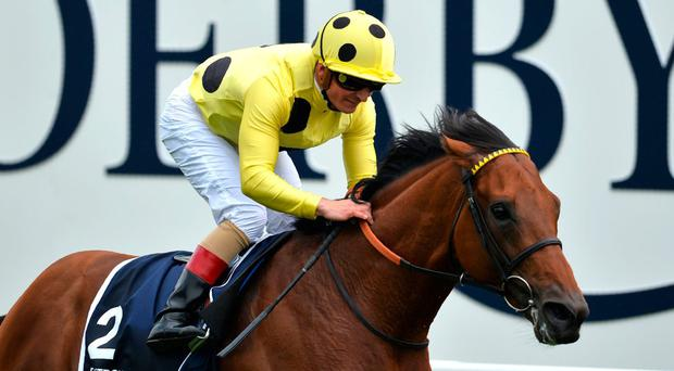 Andrea Atzeni and Postponed win the Coronation Cup at Epsom. Photo: Glyn Kirk/AFP/Getty Images