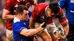 Munster's Francis Saili is tackled by Leinster's Cian Healy. Photo: Ramsey Cardy / Sportsfile