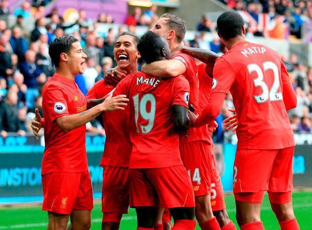 Liverpool's Roberto Firmino (second from left) celebrates scoring his side's first goal of the game. Photo: Nigel French/PA Wire.