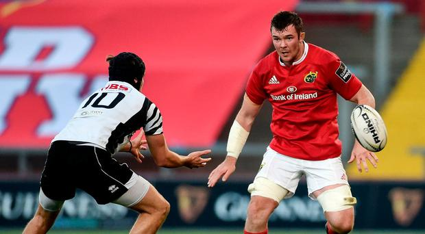 Carlo Canna of Zebre under pressure from Peter O'Mahony of Munster at Thomond Park in Limerick yesterday. Photo: Diarmuid Greene/Sportsfile