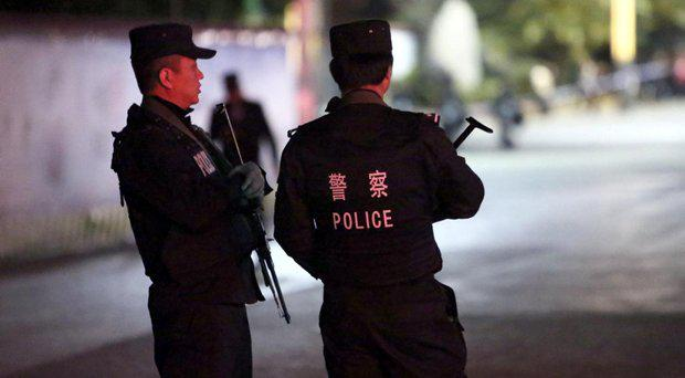 Police in Kunming, where Yang Qingpei was arrested (file photo) STR/AFP/Getty Images