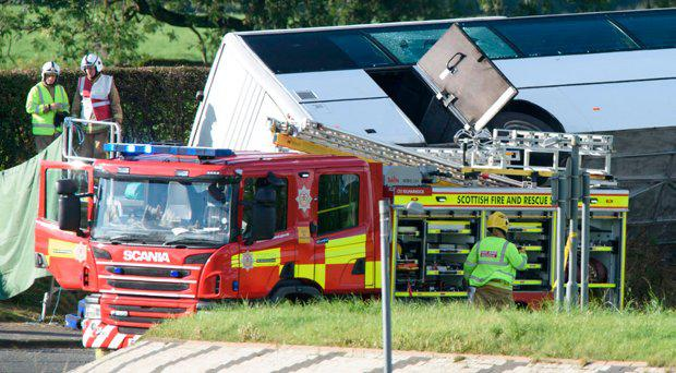 File photo dated 01/10/16 of the scene of an accident near Bowhouse Prison in Ayrshire, as tributes have been paid to a 39-year-old man who died following a Rangers supporters' bus crash which left 18 other people in hospital