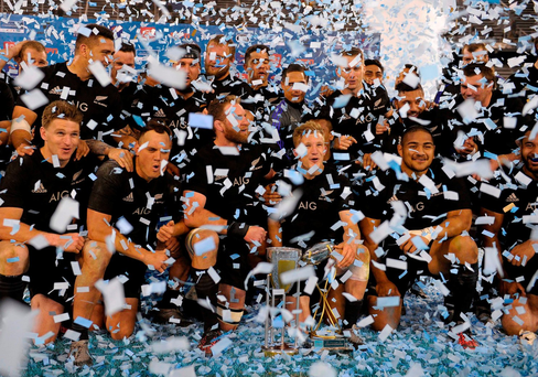 New Zealand's All Blacks rugby players pose with the Rugby Championship trophy after defeating Argentina's Los Pumas winning the tournament, at Jose Amalfitani stadium in Buenos Aires, Argentina on October 1, 2016. / AFP PHOTO / ALEJANDRO PAGNIALEJANDRO PAGNI/AFP/Getty Images