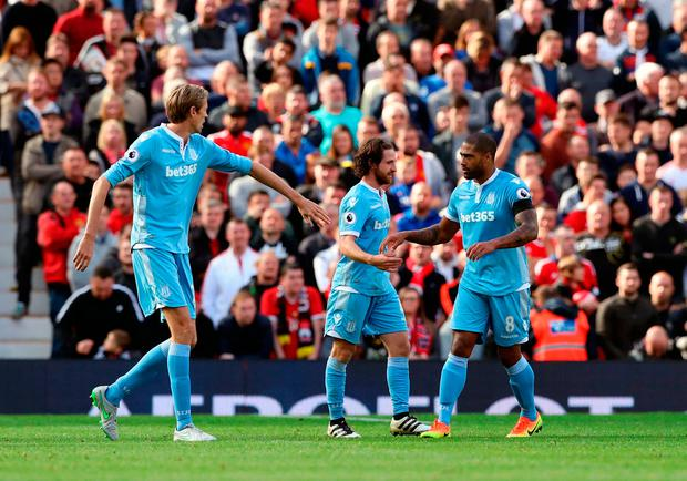 Stoke City's Joe Allen (centre) celebrates scoring his side's first goal