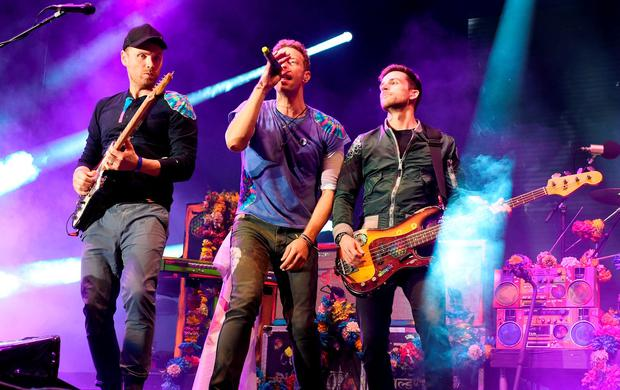 (Left-right) Jonny Buckland, Chris Martin and Guy Berryman of Coldplay. Credit: Tabatha Fireman/PA Wire