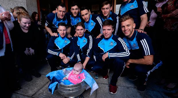 Dublin players and manager Jim Gavin with Kyra Hutchins, age 5 months, from Wexford, and the Sam Maguire cup during the Dublin team's visit to the Our Lady's Children's Hospital in Crumlin, Dublin. Photo by Piaras Ó Mídheach/Sportsfile