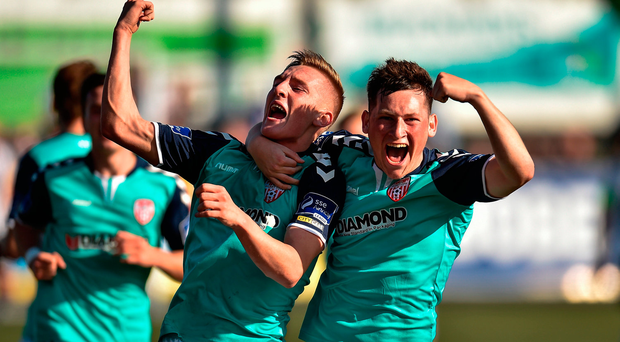 Ronan Curtis, left, of Derry City celebrates with team-mate Conor McDermott after scoring his side's second goal