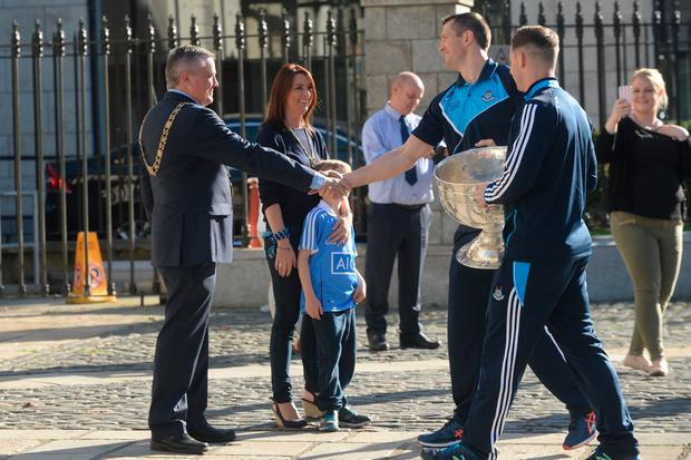 The All Ireland Champions Dublin arrive with the Sam Maguire at the Mansion House to meet the Lord Mayor and fans. Pic: Justin Farrelly.