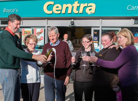 Lucky shop owner Shaun Boyce (left) celebrates outside his store after selling his third Lotto jackpot-winning ticket. North West newspix