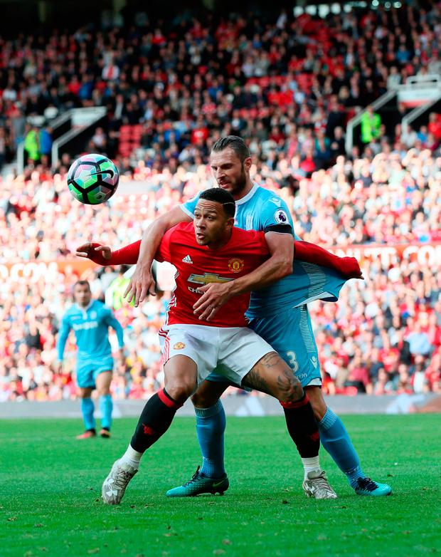 Manchester United's Memphis Depay (left) and Stoke City's Erik Pieters battle for the ball. Photo credit: Martin Rickett/PA Wire
