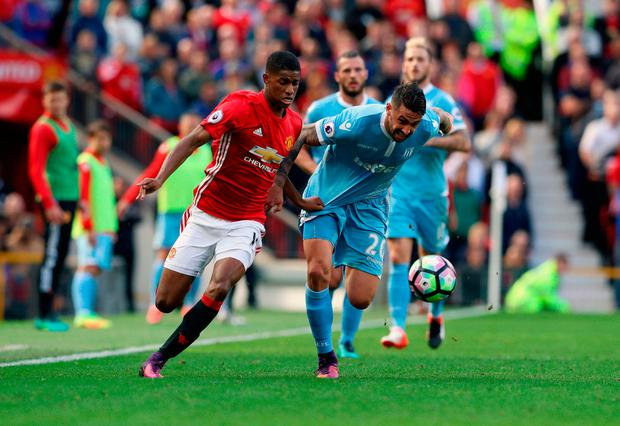 Manchester United's Marcus Rashford (left) and Stoke City's Geoff Cameron in action. Photo credit: Martin Rickett/PA Wire