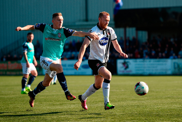 Chris Shields of Dundalk in action against Ronan Curtis of Derry City. Photo by Paul Mohan/Sportsfile