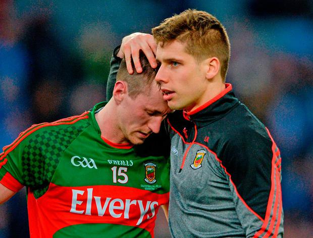 Mayo's Cillian, left, is consoled by team-mate Lee Keegan. Photo: Piaras Ó Mídheach/Sportsfile
