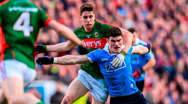 Lee Keegan fouls Diarmuid Connolly resulting in a black card for the Mayo player. Photo: Stephen McCarthy/Sportsfile