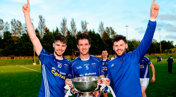 Ross McKenna, Fergal McPhillips and Conor Forde of Scotstown celebrate after yesterday's Monaghan SFC final. Photo by Oliver McVeigh/Sportsfile