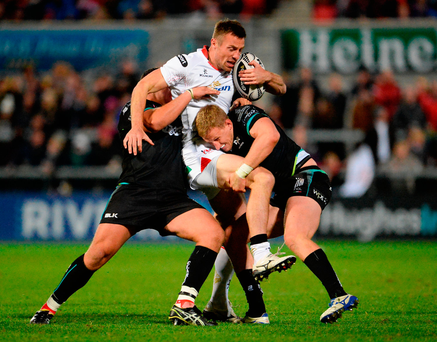 Ulster's Tommy Bowe is tackled by Ospreys' Nicky Smith and Ben John. Photo by Oliver McVeigh/Sportsfile