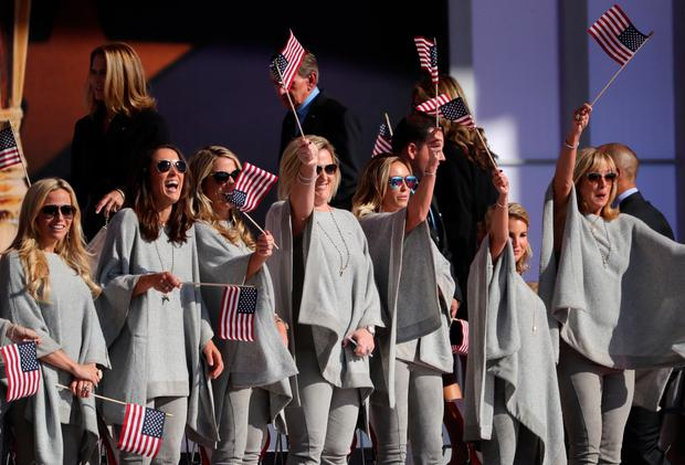 The wives and girlfriends of Ryder Cup USA players wave flags during the Opening Ceremony for the 41st Ryder Cup at Hazeltine National Golf Club. Mandatory Credit: Rob Schumacher-USA TODAY Sports