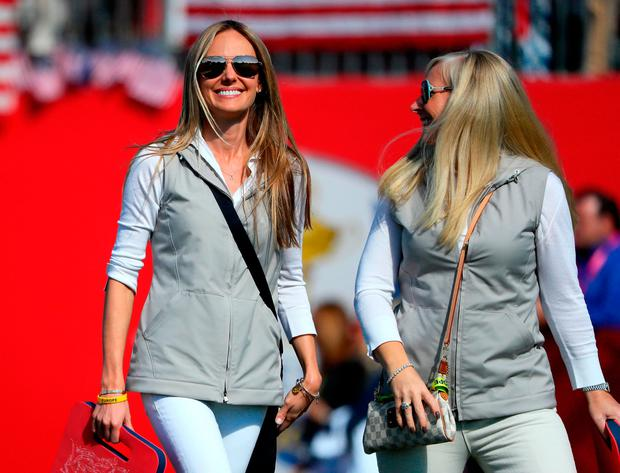 Erica Stoll and Caroline Harrington on the course yesterday. (Photo by Andrew Redington/Getty Images)