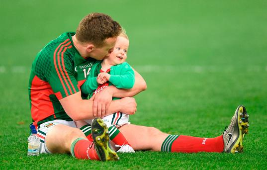 A dejected Andy Moran with his daughter Charlotte. Photo by David Maher/Sportsfile