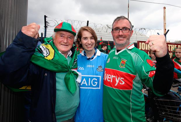 Reporter Kirsty Blake Knox with Padraic and Patrick Kelly from Ballina. Photo: Frank McGrath