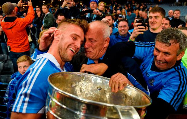 Dublin's Jonny Cooper with his father Brendan. Photo by Paul Mohan/Sportsfile