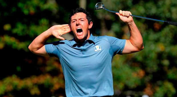 Rory McIlroy roars after sinking a monster putt on the eighth green, but the World No 3 couldn't silence Patrick Reed who won their singles match on the 18th hole. Photo: David Cannon/Getty Images