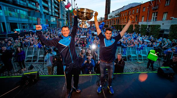Dublin players Dennis Bastick and Bernard Brogan lift the Sam Maguire cup at the homecoming for the All-Ireland final winners at Smithfield last night. 10,000 fans turned out to salute the defeated Mayo team in Castlebar. Photo: Arthur Carron