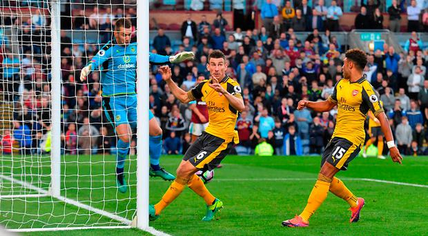 Alex Oxlade-Chamberlain's shot trickles over the line after deflecting off Laurent Koscielny (centre). Photo credit: Dave Howarth/PA Wire.