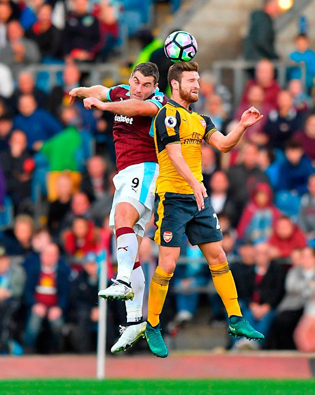 Burnley's Sam Vokes (left) and Arsenal's Shkodran Mustafi battle for the ball in the air. Photo credit: Dave Howarth/PA Wire