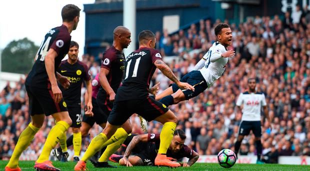 Dele Alli is fouled on the edge of the box during Tottenham's victory over Manchester City. Photo by Shaun Botterill/Getty Images
