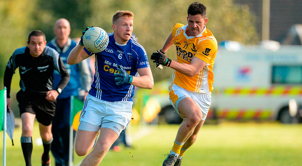 Kieran Hughes of Scotstown in action against Paul McGuigan of Clontibret O'Neill's during yesterday's Monaghan club final. Photo: Oliver McVeigh/Sportsfile