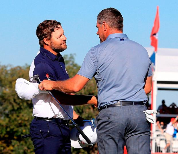 Ryan Moore is congratulated by Lee Westwood after the American's singles win secured the trophy for the home team. Photo: Sam Greenwood/Getty Images