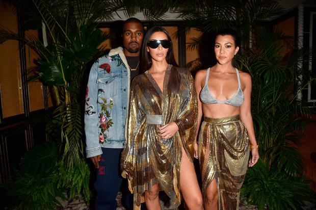 (L to R) Kanye West, Kim Kardashian and Kourtney Kardashian attend the Balmain aftershow party as part of the Paris Fashion Week Womenswear Spring/Summer 2017 on September 29, 2016 in Paris, France. (Photo by Jacopo Raule/Getty Images)