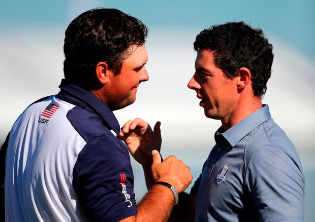 USA's Patrick Reed and Europe's Rory McIlroy shake hands