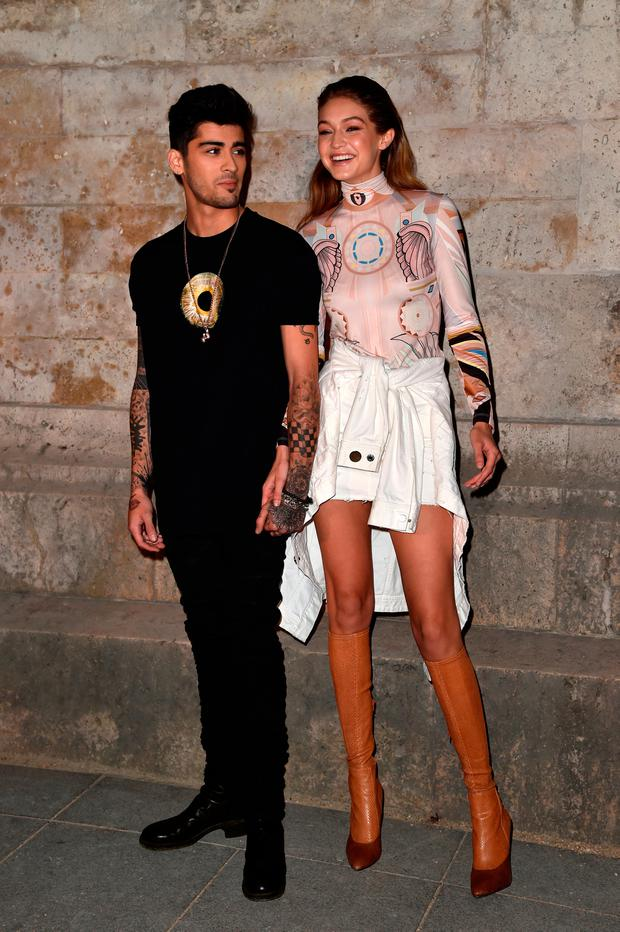 Zayn Malik and Gigi Hadid attend the Givenchy show as part of the Paris Fashion Week Womenswear Spring/Summer 2017 on October 2, 2016 in Paris, France. (Photo by Pascal Le Segretain/Getty Images)